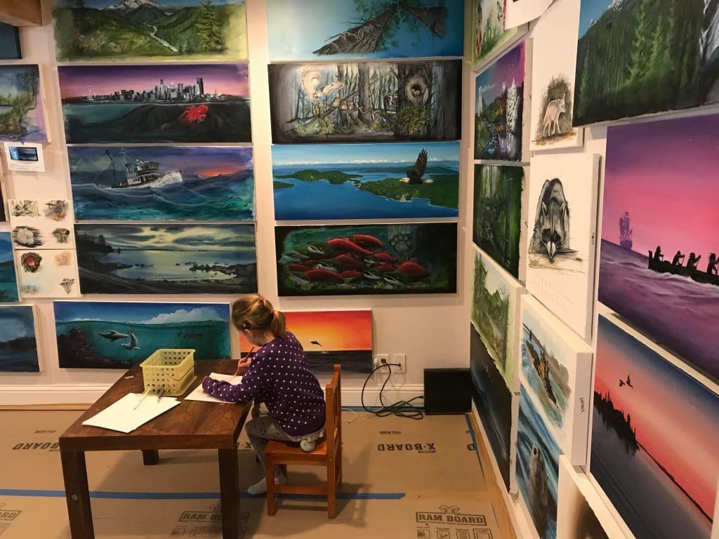 Nancy's granddaughter adrianna drawing in her father's art studio.